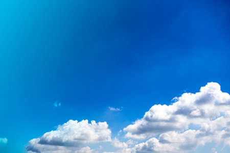 clear blue sky with plain white cloud with space for text background. close-up Reklamní fotografie