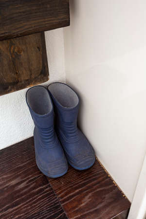 little blue rain boots in the closet, for children Stock Photo