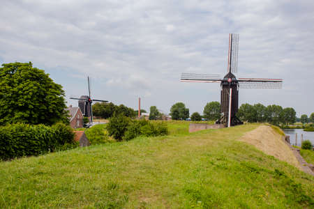 Traditional holland windmill on landscape, Heusden North-Brabant July 8