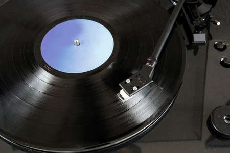 Black vinyl record lps close-up, lp turntable spinning. retro design