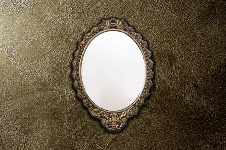 antique mirror on gold wall background texture, vintage design Reklamní fotografie