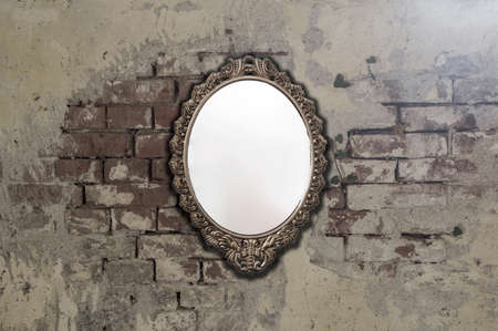 Vintage antique mirror on old brick wall background texture