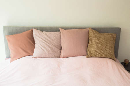 Colorful pillows ,modern bedroom with cozy double bed