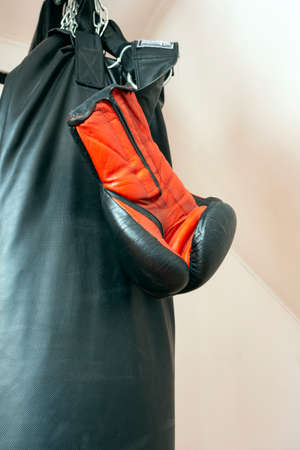 Boxing gloves and punching bag close-up sport concept