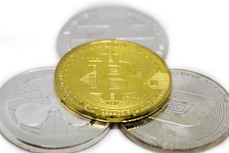Set of cryptocurrencies with a golden bitcoin on the front as the leader. Bitcoin as most important cryptocurrency concept. isolated on white Reklamní fotografie