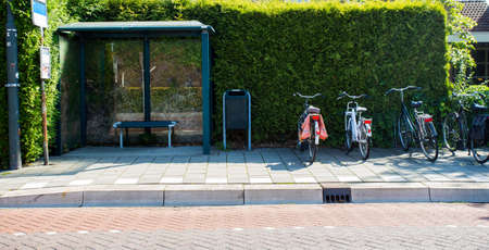 Bus shelter with bicycles, bus stop on city street, public transport