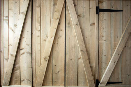 Traditional wooden barn doors detail of farm house doors, close-up clean and modern