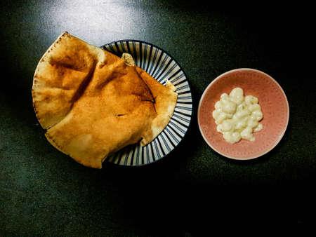 Arabian Lebanese Bread with garlic sauce top view