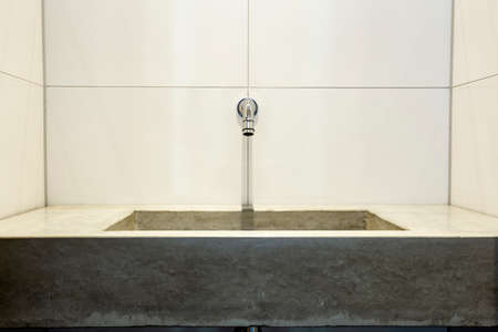 natural stone designer hand wash basin with chrome tap, sink bathroom clean and new Zdjęcie Seryjne