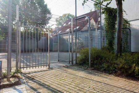 Soccer cage in the city, iron gate protection grid with soccer court behind it, empty Zdjęcie Seryjne