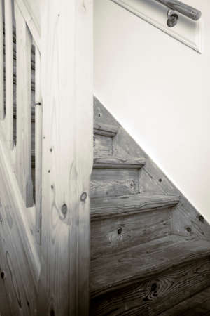 Clean and new wooden staircase in modern home interior close-up
