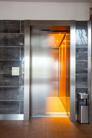 Building Elevator with moving door in apartment complex luxury Фото со стока
