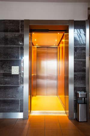 Building Elevator with open door in apartment complex luxury Фото со стока