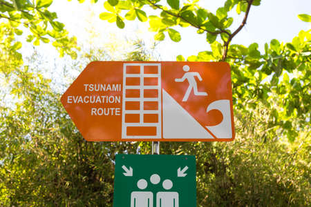 Tsunami roadsign pointing towards the stunami evacuation route, escape plam in Indonesia Bali Stock fotó