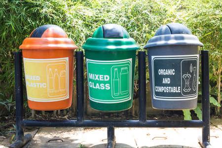Colorful Recycle Bins In The Park, multicoloured garbage trash bins Environment Archivio Fotografico