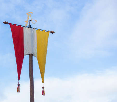 Dutch Flag of traditional festival Named Carnaval sHertogenbosch, Oeteldonk in the blue sky, red,white and yellow