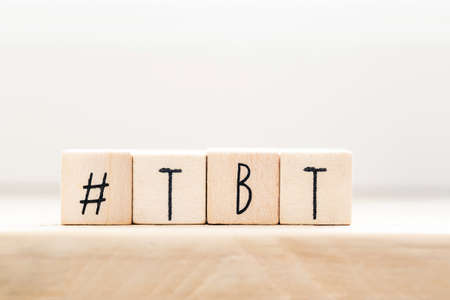 Wooden cubes with Hashtag tbt, meaning Throwback Thursday near white background social media concept Stock Photo