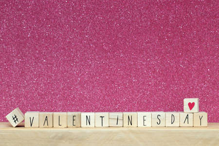 Wooden cubes with hashtag and the word valentines day, social media concept background