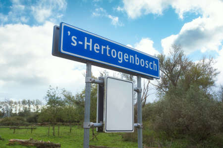 Place name sign in the Netherlands with the city s-Hertogenbosch in the blue sky