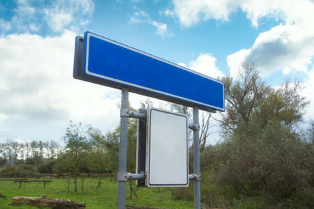 Blue Empty Road Name Sign, Isolated, Large Detailed Roadside Signage, in a blue sky Standard-Bild - 150457666
