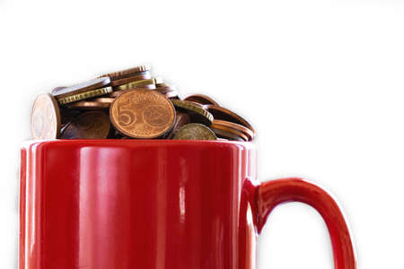 Saved Money in a colorful red mug to Finance Goals overflowing with euro coins, business concept