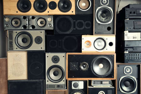 Music sound speakers hanging on the wall in retro vintage style, stacked sound boxes modern