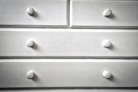 White chest of drawers modern wooden design.background texture minimalism close-up
