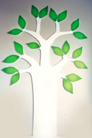 Image of Tree with green leaves with people, family tree or business tree concept on wall background empty Foto de archivo