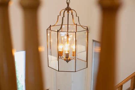 Chrystal chandelier close-up, light decor with light bulbs modern design beautiful home decoration
