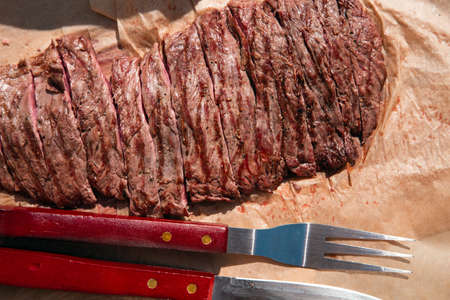 Traditional barbecue steak sliced close-up beef Bavette ready to eat, Stock Photo