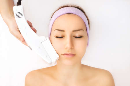 Young woman receiving laser treatment
