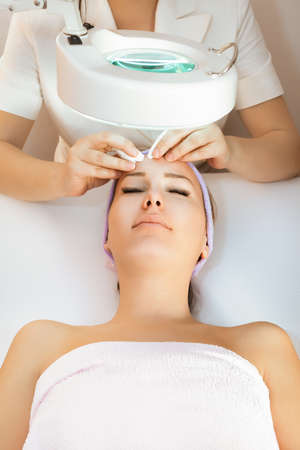 aging: Young woman receiving beauty therapy