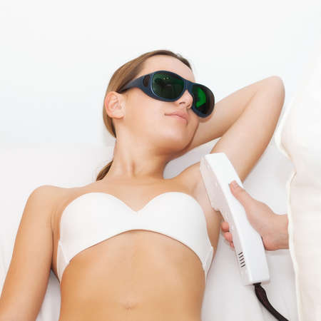 laser treatment: Young woman receiving epilation laser treatment