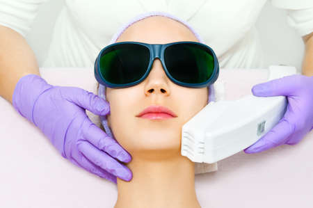 procedures: Young woman receiving laser therapy