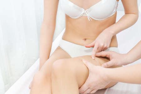 dermatologist: Dermatologist inspecting woman patients skin