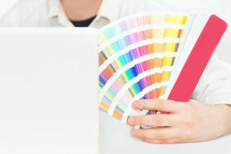 pantone: Close up of designer holding pantone palette