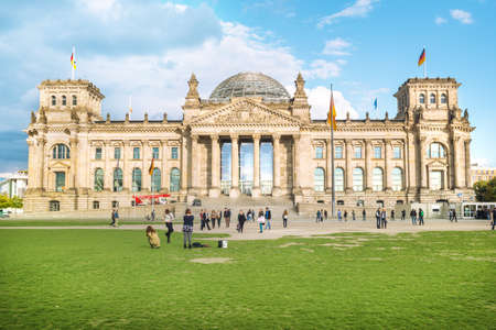 Front view of Reichstag on sunny day, with people around