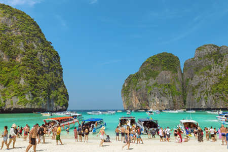 Famous Maya Bay at Ko Phi Phi Lee Island, part of the Phi Phi Islands, crowded with tourists comming with boat tours, on December 15th 2017