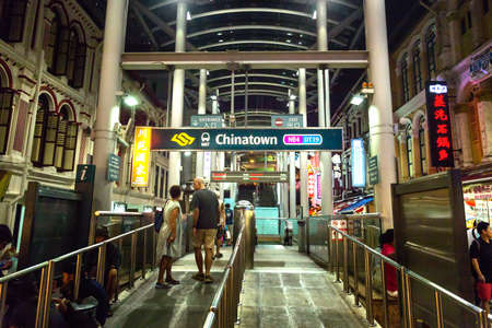 Entrance to the subway station in Chinatown  in Singapore, at night Editorial