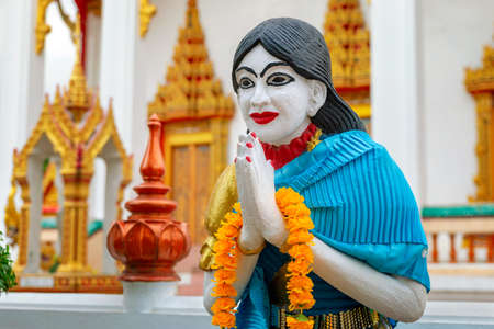Female statue in the Wat Chalong temple complex, Phuket, Thailand Stock Photo
