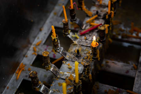 Candles in front of a temple at Wat Chalong temple complex, Phuket, Thailand