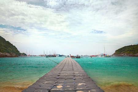 Pontoon pier with the boats on Patok beach, Koh Racha Yai Island, Thailand