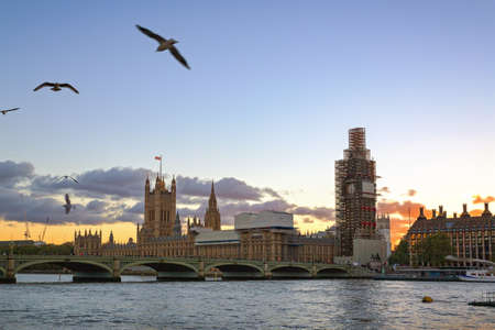 Big Ben under construction, Houses of Parliament and Westminster Bridge in sunset