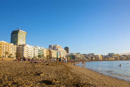 Las Palmas de Gran Canaria, Spain, on December the 26, 2018. Tourists on the beach  Las Canteras with hotels in the background