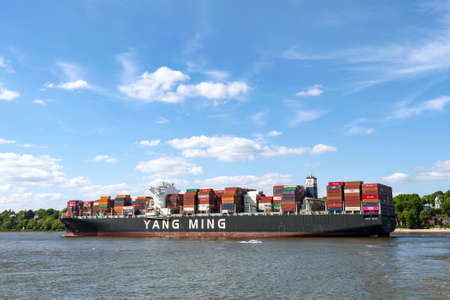 Hamburg / Germany - May the 11th, 2019: Container ship Yang Ming on the river Elbe in Hamburg, Germany
