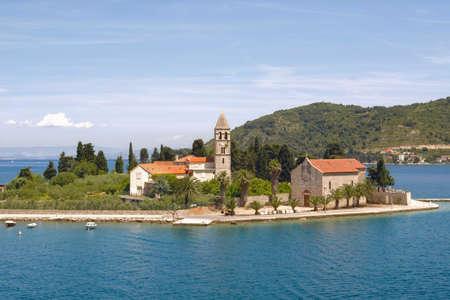 Prirovo Peninsula with Franciscan monastery, Vis Bay, Croatia Standard-Bild