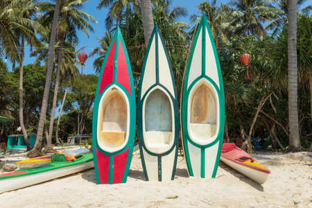 Kayaks and canoes on the island May Rut in Kien Giang, Vietnam