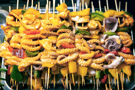 Baby octopus skewers with vegetables at night market in Phu Quoc, Vietnam