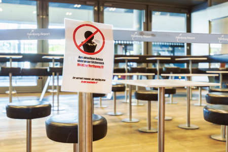 Hamburg, Germany - March 29 2020: Notification for the passengers on the airport in Hamburg during the Corona pandemic, written both on German and English saying that the seating area is not available