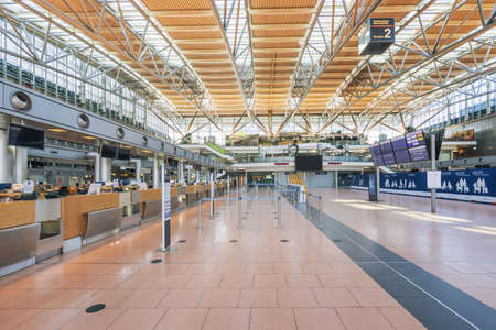 Hamburg, Germany - March 29 2020: Terminal 2, departure floor at airport in Hamburg, empty because of corona virus pandemic